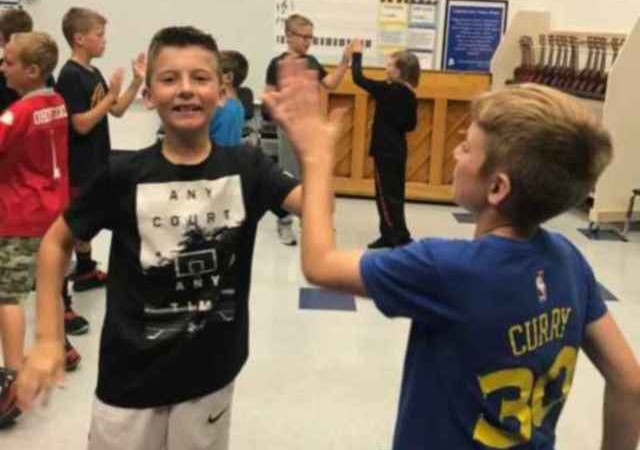 Fourth grade students learning folk dances from around the world.