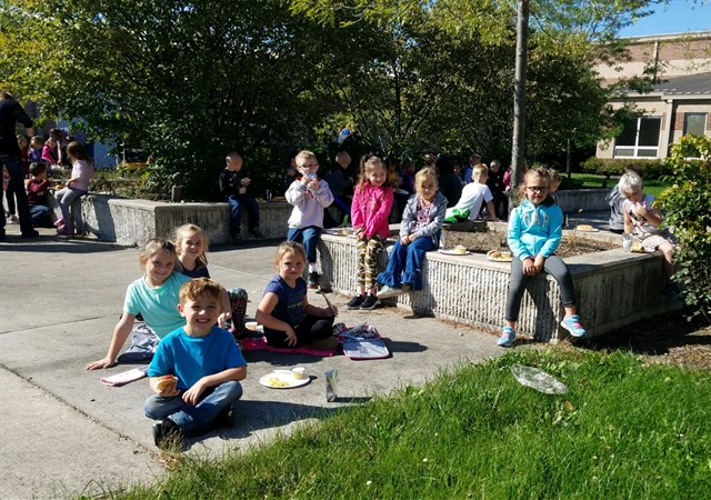 Kindergarten students enjoying a picnic as part of their camp unit.